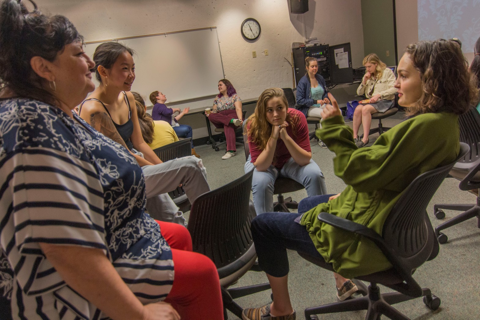 Students sit in small circles as mentor and mentees introduce themselves to one another.